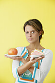 Woman offering two plates with food