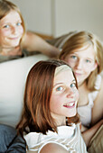 Three teenage girls on lounge