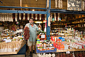 Seller offering products, Seller offering products, Central Market Hall, Pest, Budapest, Hungray