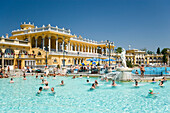 People in open-air swimming pool, People swimming in open-air pool of Szechenyi-Baths, Pest, Budapest, Hungary