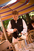 Waiter presenting the wine, Waiter presenting the wine in the open-air area of the restaurant Gundel, Pest, Budapest, Hungary