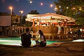 People in the Zoeld Pardon, Couple in the open-air nightclub Zoeld Pardon near the Petoefi Bridge, Buda, Budapest, Hungary
