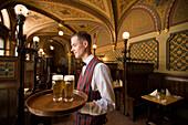 Waiter serving beer in the Karpatia Restaurant, Waiter serving beers in the Karpatia Restaurant, Pest, Budapest, Hungary