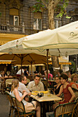 People in open-air cafe, Young people sitting in an open-air Cafe at Liszt Square, Pest, Budapest, Hungary