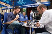 Two men playing chess, Two men playing chess in an open-air restaurant at Raday Street, Pest, Budapest, Hungary