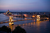 View over the river Danube with Szechenyi Chain Bridge to Pest with the Parliament in the evening, Pest, Budapest, Hungary