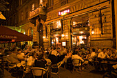 People in the open-air Cafe Karma at night, People sitting in the open-air Cafe Karma at Liszt Square at night, Pest, Budapest, Hungary