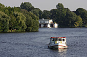 Pleasure boat on lake Aussenalster, river Alster, Harvestehude, Hamburg, Germany