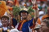 Dutch football fans wearing a headdress