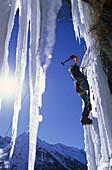 Man ice climbing, Dolomites, South Tyrol, Italy
