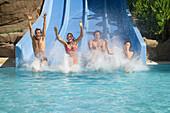 People sliding into pool