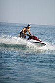 Man riding jetski, sports man on jetski
