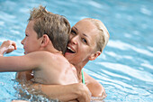 Woman with boy in pool
