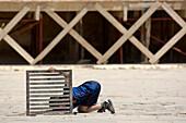Boy searching for something, Place el Hedim, Meknes, Morocco