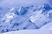 Snowcovered mountain scenery, skier standing in the background, Kuehtai, Tyrol, Austria