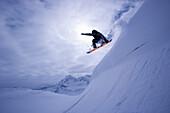 Snowboarding big jump, Kuehtai, Tyrol, Austria