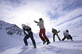Young people having fun with snowball fight, Kuehtai, Tyrol, Austria