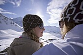 Young couple sitting near slope, Kuehtai, Tyrol, Austria