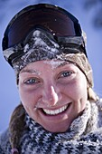 Young woman wearing ski googles, portrait, Kuehtai, Tyrol, Austria
