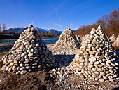 Stacked stones on the riverside, near Bad Toelz, Upper Bavaria, Germany