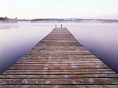 Wooden pier over body of water, Kirchsee, Upper Bavaria, Germany