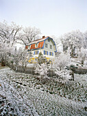 Museum former House of Gabriele Muenter painterss and partner of Wassily Kandinsky painter and founder of the artist group Der blaue Reiter, Frost covered landscape with country house, Murnau, Upper Bavaria, Germany