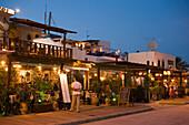 Restaurants near quay at promenade in the evening, Kardamena, Kos, Greece