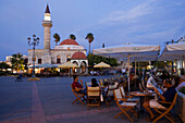 View over the Platia Eleftherias to a pavement cafe at Defterdar-Mosque, Kos-Town, Kos, Greece
