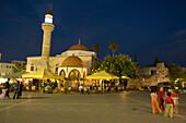 View over the Platia Eleftherias to a pavement cafe at Defterdar-Mosque, Kos-Town, Kos, Greece