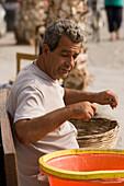 Fisher sorting fishing at harbour, Kos-Town, Kos, Greece