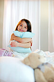 Girl hugging a pillow