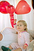 Little girl with red balloons