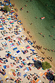 Aerial shot of peopled Paradise Beach, Mykonos, Greece