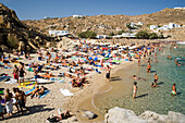 People bathing at Super Paradise Beach, knowing as a centrum of gays and nudism, Psarou, Mykonos, Greece