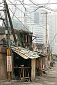 demolition quarter, encroaching new highrise, Shanghai