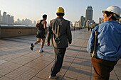 construction workers, jogger