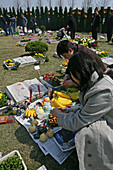 Fu Shou Yuan cemetery,cemetery during Ching Ming Festival, prayers for dead, ancestors, family offers food, wine, fruit to the dead people, show their respect, prayer, 5th of April