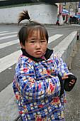 kid, child,young girl near Souzho Creek, street children, homeless, winter coat