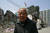 last elderly resident, demolition in old town, Lao Xi Men, Shanghai