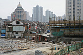 demolition in old town, Lao Xi Men,redevelopment area, living amongst demolished houses, slum, Living amongst ruins, encroaching new highrise