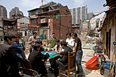 demolition in old town, Lao Xi Men,redevelopment area, living amongst demolished houses, migrant worker, living in demolished houses and self built shacks, slum, Living amongst ruins, playing majong
