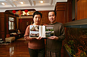 couple, Yan Hang Mei,at home with her husband, photo album with images from Salem, private house, fengshui aquarium, Feng Shui