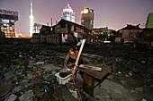 living amongst demolished houses, Hongkou, Shanghai