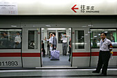 Metro Shanghai,mass transportation system, subway, public transport, underground station, Guard, commuters