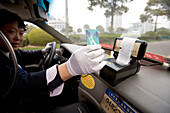 Taxi Shanghai, paying with plastic money, reciept, electronic