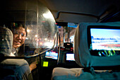 Taxi Shanghai, female taxi driver, protection shield, TV Screen, happy, laughing, happy, happiness