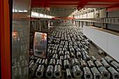 """ThyssenKrupp,Stahl für China, Stahllager und Walzwerk, Kranfahrerm steel, Stahlblechrolle, hall, Lagerhalle, steel work, plant, sheet metal, crane driver, operator, rolled steel, rolling mill, aus: """"Mythos Shanghai"""", Shanghai, Sachbuch, Bildband, Fotos Ka"""