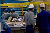 ThyssenKrupp,Stahl für China, Stahllager und Walzwerk, Kranfahrerm steel, Stahlblechrolle, hall, Lagerhalle, steel work, plant, sheet metal, Monitor, Kontrollmonitor, Stahlarbeiter, steelworker, rolled steel, rolling mill