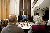 old couple in modern villa,old couple with big TV screen, living room, luxury apartment, western Shanghai, interieur, private house, interior, new suburb