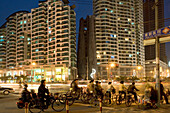bicycle traffic, apartment towers at night, Zhabei district, Shanghai